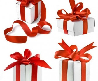 White Gift Boxes with Red Ribbon Over White Background